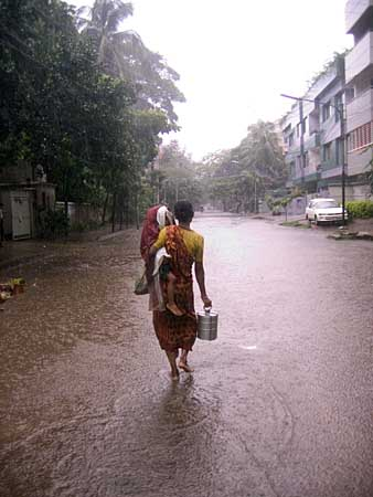 working mother in rain
