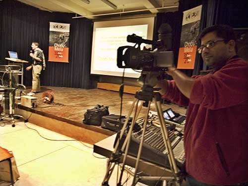 Muhammad Amin doing video recording for web=streaming during Dick Doughty's presentation. Shahidul Alam/Drik/Majority World