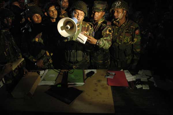 Army members are announcing the name of founded dead bodies of the BDR and army personals in BDR headquarters this evening. Till now there are total 67 dead bodies found from the BDR headquarters and outside areas. Dhaka, Bangladesh. February 27 2009