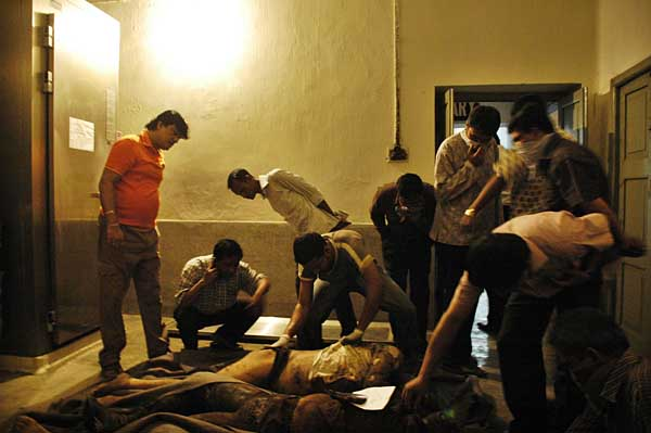 Family members are trying to identify the dead bodies of BDR and army personals in Dhaka medical Mortuary this evening. Till now there are total 67 dead bodies found from the BDR headquarters and outside areas. Dhaka, Bangladesh. February 27 2009