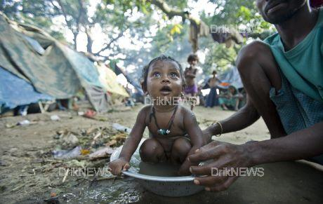 A father bathes a rescued child in a relief camp in Banmankhi Purnea after surviving the wrath of the Kosi river when it burst its fortified embankments. Flooding has been held at bay for 45 years but nature and man-made environmental degradation seems to have changed the course of the river this time. The unprecedented floods claimed 63 lives and made over 3.3 million people destitute in India.©   Bihar, India. September 08 2008