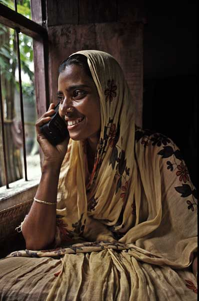 Salma, a housewife in Norshingdi, receives a call from her husband, a migrant labourer in Singapore. Rural women in Bangladesh have set up small mobile phone businesses which now allow easier communication in villages.