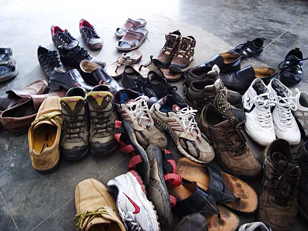 Footwear of Bangladeshi and Norwegian students outside the classroom of Pathshala where Philip Blenkinsop is conducting a class. Shahidul Alam/Drik/Majority World