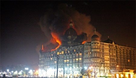 A fire breaks out of the dome of the Taj hotel in Mumbai on November 26. AFP
