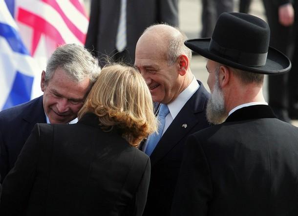 US outgoing president George W Bush kisses Israeli foreign minister Livni as Israeli Prime Minister Ehud Olmert and looks on. Tel Aviv's Ben Gurion International Airport 09 January 2008.  MARCO LONGARI/AFP/Getty Images)
