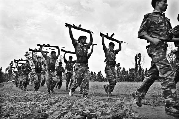 Maoist People Liberation Army (PLA) during their armed display at their camp in Harnamadi of Makwanpur district. More than 13,000 people were killed and 1,00,000 displaced since the communist rebels launched their armed struggle against the state in 1996. King Gyanendra's direct rule ended in April 2006 after the rebels entered talks on how to end the civil war. A landmark peace deal was agreed in November and in early 2007 the Maoists joined an interim government. CPN-Maoist won the highest number of seats in the Constitutional Assembly election and became the largest political party of the Nepal. The maoist joined the main stream politics in 2006 after fighting decade long arm conflict. Nepal has been declared as a Republic country, doing away with the 239 years old monarchy of the Shah dynasty. Sailendra