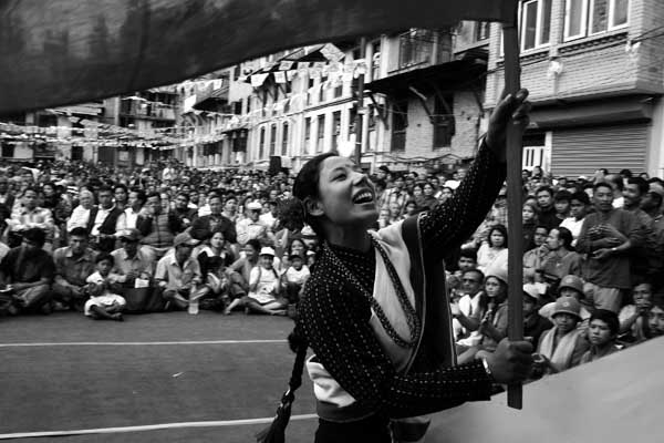 A maoist supporter ethinic girl waves the party flag of CPN-Maoist during their election campaign at Lalitpur,Nepal on March 24, 2008 for up-comming constitution assembly election. CPN-Maoist won the highest number of seats in the election and became the largest political party of the Nepal. The maoist joined the main stream politics in 2006 after fighting decade long arm conflict. Nepal has been declared as a Republic country, doing away with the 239 years old monarchy of the Shah dynasty. Sailendra Kharel