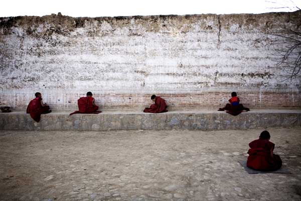 Young monks praying inside the monastery in Tongren, which is located in one of the Tibetan-areas in China. Mads Nissen