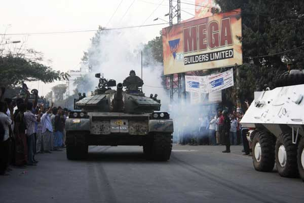 After the military was initially kept back, tanks were deployed. More than 10 tanks and one APC (armed personnel carrier) took position in front of Abahani sports ground, while soldiers took position inside the field. 26th February 2009. Amdadul Huq/DrikNews